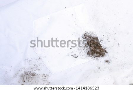 Dirty stain on fabric from accident in daily life. dirt stains for cleaning work house  #1414186523