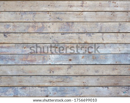 Dirty surface from old unpainted floorboards with stains of rust, paint, engine oil and lime. The boards are laid horizontally. Floor in a dilapidated production room. View from above Stock photo ©