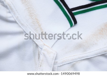 dirty sweat stain on collar shirt from daily life activity. dirt stains for clean and wash concept  #1490069498