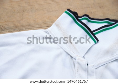 dirty sweat stain on collar shirt from daily life activity. dirt stains for clean and wash concept  #1490461757