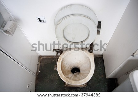 Dirty toilet in a train