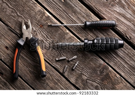Dirty tools set on old wooden background.