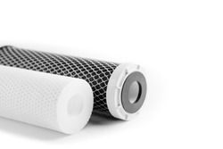 Dirty water filter cartridges on white background. carbon filter