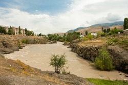 Dirty water of the river Naryn in Kyrgyzstan, Central Asia.