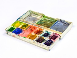 dirty watercolor palette with many colors