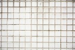 dirty white ceramic tile at the bathroom