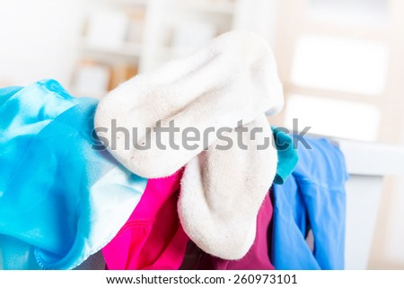 Dirty white socks on a hamper or basket #260973101