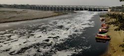Dirty Yamuna River at Gokul the Holy place where Lord Krishna spend his childhood. Gokul is near Mathura, Uttar Pradesh - India. Industrial & House hold waste has turned the fortune great holy river.