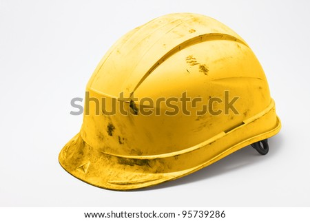 Dirty yellow hard hat on white background
