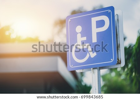 disability car parking sign to reserved space for handicap driver vehicle park