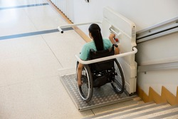 Disability stairs lift facility indoor building Wheelchair elevator.