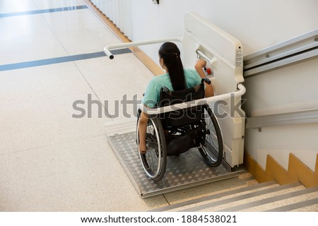 Disability stairs lift facility indoor building Wheelchair elevator. Foto stock ©