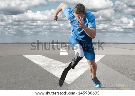 Disabled athlete with  explosive start on the runway