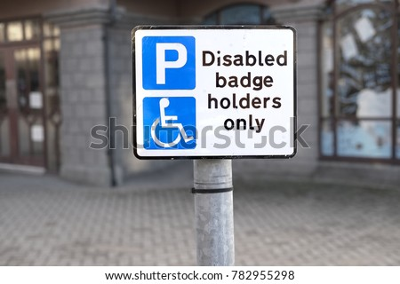 Disabled Badge Holders Only at Car Park Sign Post #782955298