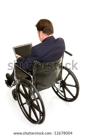 Disabled businessman in wheelchair working on computer.  Full body isolated on white.
