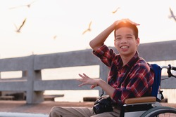 Disabled child on wheelchair is smiling,playing,learning in the outdoor park activity like other people,Lifestyle of special child, Life in the education age of children, Happy disability kid concept.