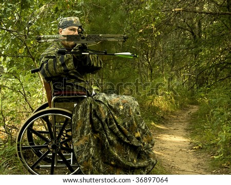 disabled hunter in wheelchair using a crossbow