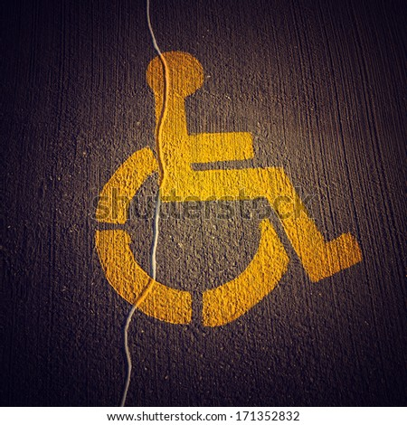 Disabled icon on broken asphalt background #171352832