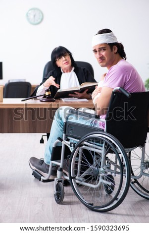Disabled man consulting judge for damages litigation