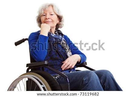 Disabled old senior woman sitting in a wheelchair
