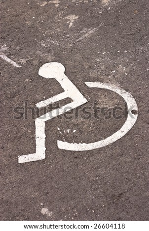 disabled parking sign on asphalt
