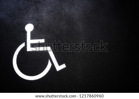 Disabled people icon or Handicap symbol on parking space.Sign design on urban asphalt road.Wheel chair logo on copy space empty blank.Disability Concept. - Shutterstock ID 1217860960
