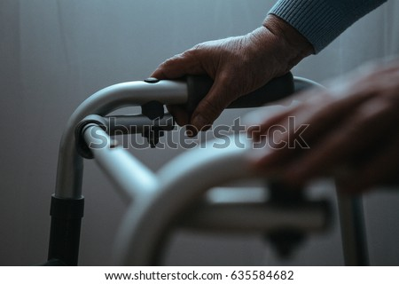 Shutterstock Disabled person holding hands on walker, close up