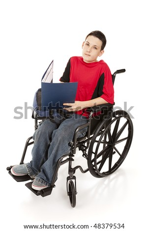 Disabled schoolboy in his wheelchair.  Full body isolated.