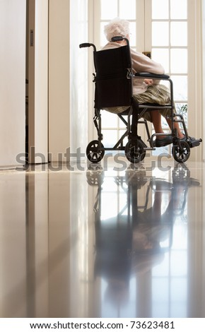 Disabled Senior Woman Sitting In Wheelchair