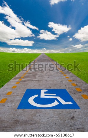 disabled sign board on the way - stock photo