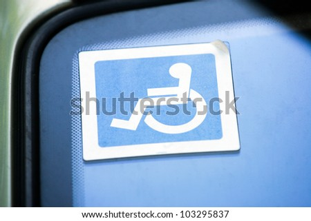 Disabled sign on the car glass