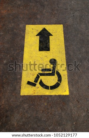 Disabled sign, outdoor symbol #1052129177