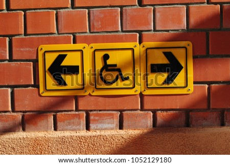 Disabled sign, outdoor symbol #1052129180