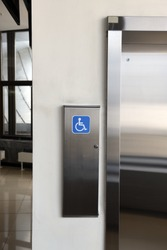 disabled signage, Modern steel elevator cabins in a business lobby or Hotel, Store, interior, office,perspective wide angle.