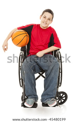 stock photo : Disabled teen boy enjoys playing basketball.