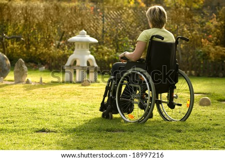 Disabled  woman in a wheelchair - stock photo