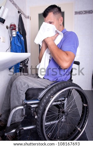 disabled young man in the wheelchair on morning care