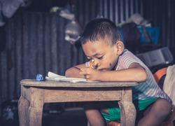 Disadvantaged Children doing homework.