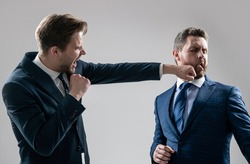 disagreed men business partners or colleague disputing and fighting aggressive and angry while conflict, knockout.