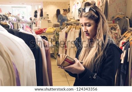 Disappointed blonde girl in clothing store