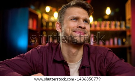 Disappointed caucasian man watching sport competition in pub, team losing game