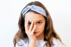 Disappointed child. Failure regret. Shame embarrassment. Portrait of unhappy displeased little girl showing facepalm gesture isolated on white background.