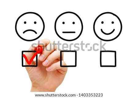 Disappointed client leaving negative evaluation with red marker check mark on customer feedback survey. Unhappy drawn face concept. #1403353223