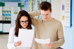 Disappointed college students with bad test results. Two learners failed their final examination