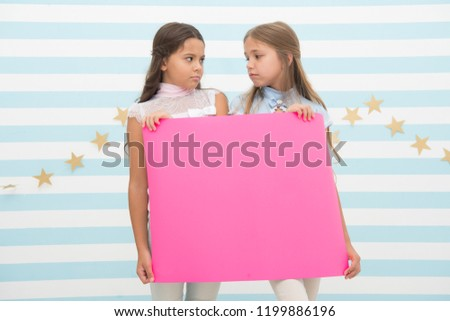 Disappointing news. Girl hold announcement banner. Girls kids holding paper banner for announcement. Children sad with blank paper announcement copy space. Kids announcement concept. #1199886196