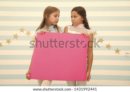 Disappointing news. Girl hold announcement banner. Girls kids holding paper banner for announcement. Children sad with blank paper announcement copy space. Kids announcement concept. #1431992441