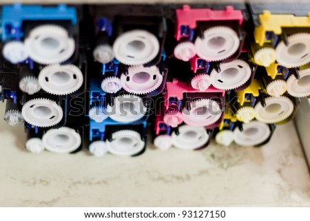 disassembled colour cartridges of color printer