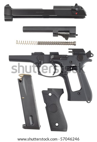 Disassembled handgun on a white background