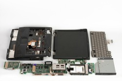 Disassembled laptop, basic components of notebook, screen, keyboard, processor,  motherboard,internal  hard disk drive, cd drive