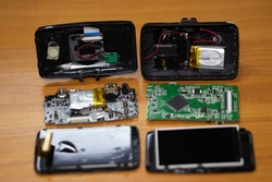 Disassembly the parts of Car camcorder or Dashboard camera (Car Camera) are separated for repair on the wood board